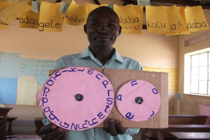 Mr Dramani, a P3 teacher in one of his literacy lessons in local language