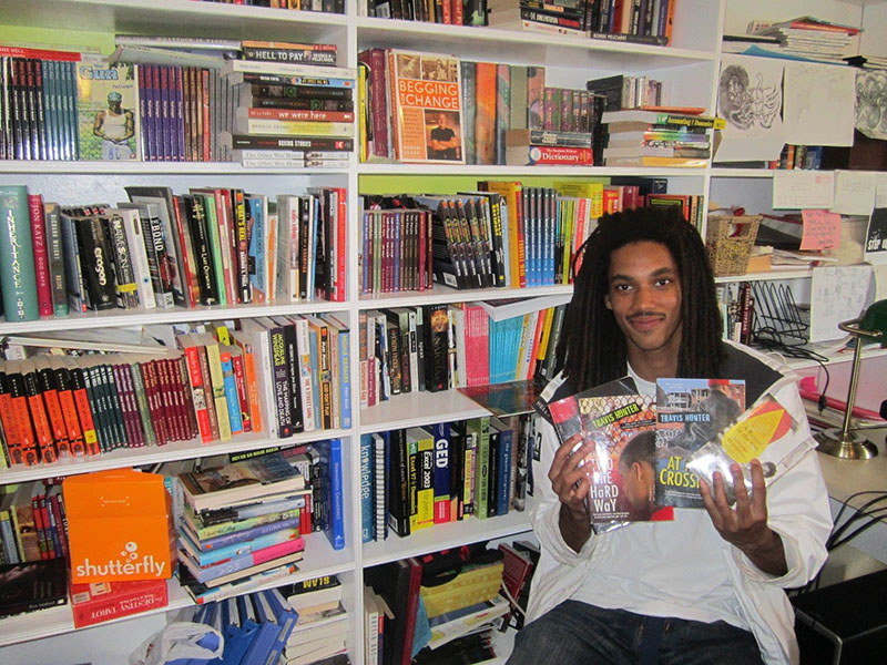 A Free Minds member, home from prison, with his favorite books at the Free Minds office